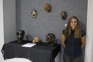 Em Harris with ceramic masks